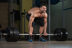 Male Fitness Athlete Lifting Deadlift In The Gym